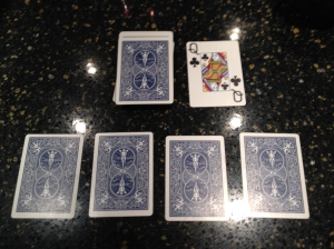 How a player's hand looks--draw deck and pile are in the middle of all hands being played.